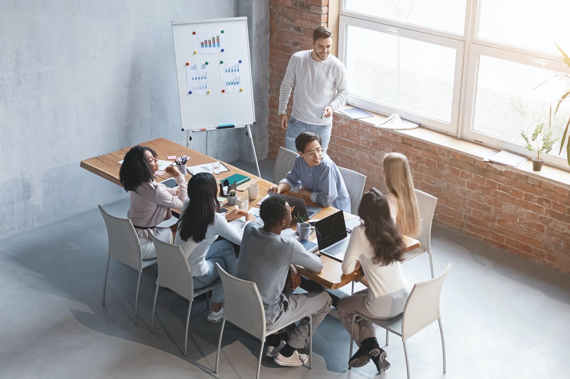 Creative business team listening to marketing report