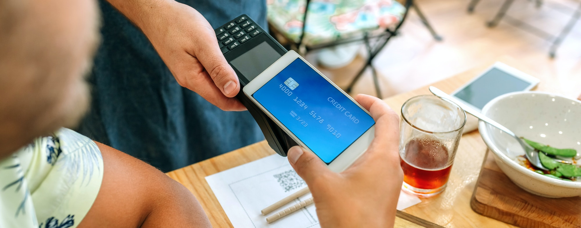 Customer paying the restaurant bill with a virtual mobile card